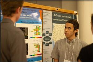 Brandon Garcia presenting a poster at the AMS meeting.